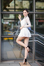 Picture Asian Pose Frock Legs Staring young woman