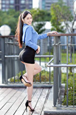 Pictures Asiatic Pose Legs Skirt Smile Blouse Staring female