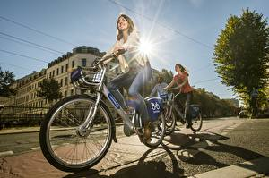 Images Bike Street Rays of light Brown haired Motion Smile Jeans Cities