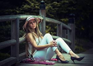 Photo Fence Dark Blonde Hat Sit Hands Legs Stilettos young woman