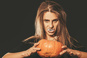 Images Halloween Pumpkin Fingers Canine tooth fangs Black background Brown haired Girls