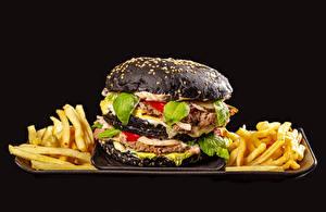 Images Hamburger Finger chips Frikadeller Black background Black