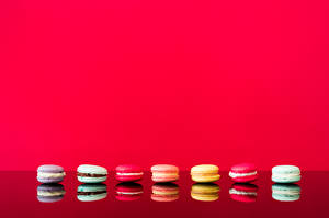 Pictures French macarons Reflection Red background Template greeting card Food