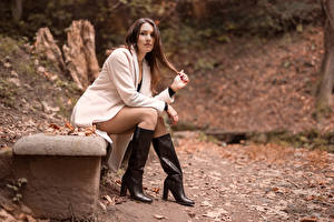 Picture Brown haired Coat Wearing boots Legs Sitting Glance Nadia female
