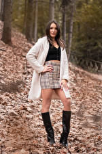 Picture Brown haired Posing Legs Wearing boots Skirt Overcoat Foliage Glance Nadia young woman