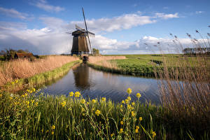Pictures Netherlands Mill Canal Clouds Nature