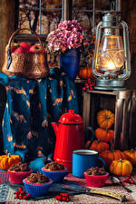 Images Still-life Kerosene lamp Apples Bouquet Hydrangea Pumpkin Little cakes Coffee Wicker basket Mug Dog rose berries Food Flowers