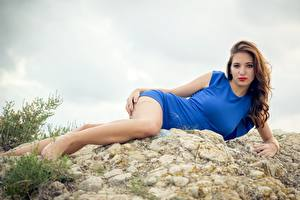 Photo Stone Brown haired Dress Lying down Hands Legs female