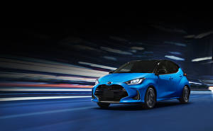 Image Toyota Light Blue Moving 2020 Yaris Hybrid automobile