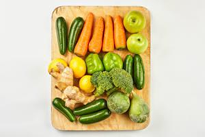 Wallpaper Vegetables Apples Lemons Carrots Bell pepper Zucchini Gray background Cutting board