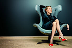 Pictures Wing chair Brown haired Smile Frock Legs Stilettos young woman
