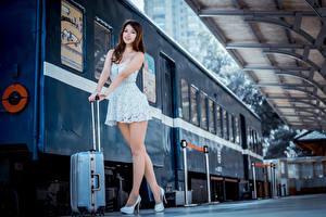 Wallpapers Asiatic Trains Pose Dress Suitcase Staring Legs Brown haired Girls