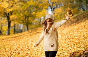 Wallpaper Autumn Blurred background Foliage Sweater Winter hat Smile Girls Nature