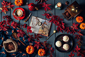 Desktop wallpapers Autumn Pumpkin Little cakes Coffee Cappuccino Pocket watch Knife Candles Still-life Wood planks Leaf Cup Grain Books Food