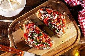 Fotos & Bilder Brot Butterbrot Schneidebrett Geschnitten Bruschetta Lebensmittel