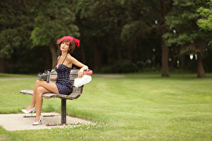 Images Retro Grass Bench Brown haired Hat Dress Sitting Legs Stilettos Camera Casey Carlson young woman