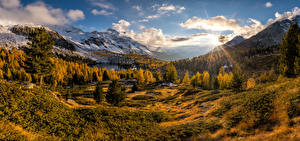 Pictures Switzerland Autumn Mountain Landscape photography Sky Alps Clouds Sun Valdidentro, panorama Nature