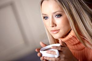 Pictures Tea Blonde girl Glance Sweater Hands Mug Face female