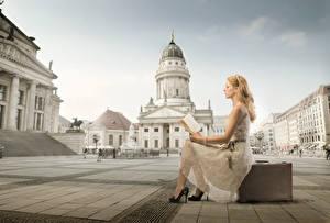 Image Town square Suitcase Book Blonde girl Dress Sit Reading Girls