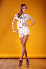 Image Viacheslav Krivonos Model Posing Legs Shorts T-shirt Colored background Girls