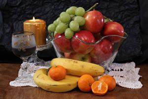 Fotos Wein Kerzen Äpfel Weintraube Bananen Mandarine Weinglas das Essen