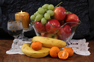 Fotos Wein Kerzen Äpfel Weintraube Bananen Mandarine Weinglas