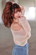 Pictures Asian Blurred background Posing Smile Staring Redhead girl young woman