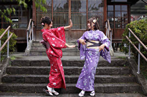 Pictures Asiatic Two Smile Hands Kimono young woman