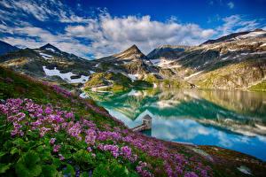 Bureaubladachtergronden Oostenrijk Bergen Een meer Alpen Wolken Weerspiegeld  Natuur