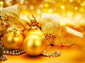 Desktop wallpapers Christmas Balls Ribbon Gold color