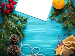 Fotos Neujahr Kekse Beere Ast Zapfen Blatt Papier Vorlage Grußkarte