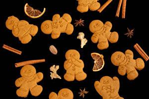 Image Christmas Cookies Cinnamon Star anise Illicium Black background Design Food