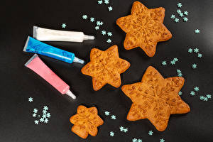 Photo New year Cookies Gray background Snowflakes Food