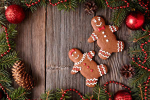 Desktop wallpapers New year Cookies Wood planks Branches Balls Pine cone Food