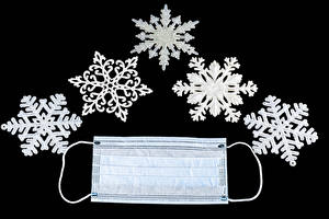 Fotos Neujahr Coronavirus Maske Schwarzer Hintergrund Schneeflocken