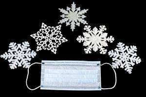 Bureaubladachtergronden Kerst Coronavirus Maskers Zwarte achtergrond Sneeuwvlok