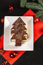 Photo Christmas Little cakes Chocolate Gray background Design Christmas tree Balls Branches Food