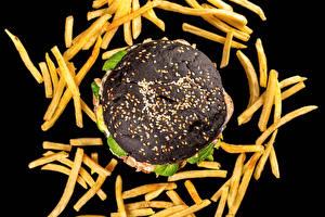 Bureaubladachtergronden Frieten Hamburger Zwarte achtergrond Zwart kleur spijs