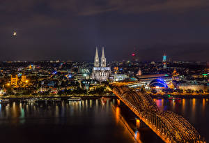 Pictures Germany Cologne Building Rivers Bridge Marinas Night time Cities