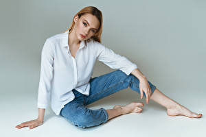 Photo Model Sitting Jeans Blouse Staring young woman