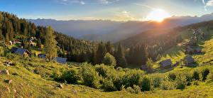 Bakgrundsbilder på skrivbordet Slovenien Soluppgångar och solnedgångar Byggnader Skogar By Buskar Planina Zajamniki Natur