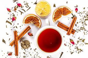 Images Tea Cinnamon Lemons Orange fruit White background Cup Food