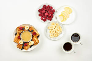 Pictures Waffle Honey Coffee Raspberry Bananas White background Breakfast Cup Plate Food