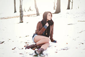 Pictures Winter Snow Brown haired Jacket Sitting Legs Boots Katie Joanne young woman