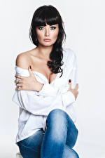 Picture Brunette girl Modelling Sitting Jeans Blouse Hands Staring Yulia female