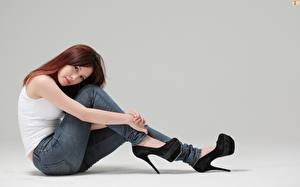 Wallpapers Asian Gray background Brown haired Sitting Hands Legs High heels Jeans Girls