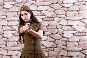 Image Asiatic Pistols Wall Made of stone Uniform Hands Glance Police Girls
