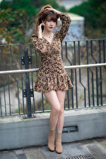 Pictures Asiatic Pose Gown Legs Staring young woman