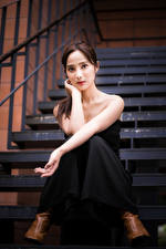 Image Asian Sitting Stairway Hands Staring young woman