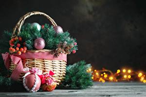 Images New year Berry Wicker basket Branches Balls